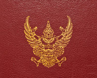 Gloden garuda on red leather Royalty Free Stock Images