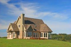 Gloednieuw Huis Stock Foto
