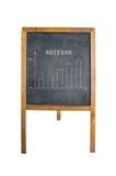 Gloeiende grafiek op schoolbord met woordsucces Stock Afbeelding