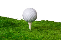 Glolfing up hill. Golf ball on a tee with the grass up hill Royalty Free Stock Photos