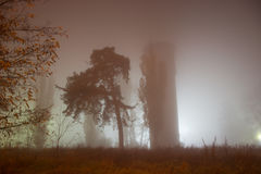 Gloom place in the fog. Gloomy water tower, tree in the fog stock photos