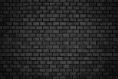 Gloomy background, black brick wall of dark stone texture Royalty Free Stock Photo