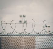 Gloomy prison barbed wire royalty free stock image