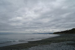 Gloomy Beach. Shot at the southern shores of Victoria, BC Royalty Free Stock Photography