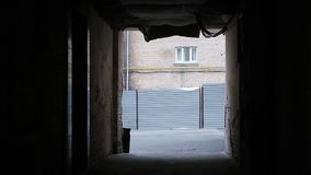 Gloomy brick building seen at the end of dark tunnel, abandoned strange place. Stock footage stock footage