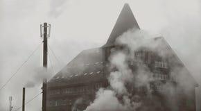 Gloomy building in the skull-shaped fog stock image