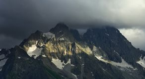 Gloomy Caucasus. This is gloomy summits in Caucasus mountains in evening royalty free stock photo