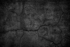 Gloomy concrete wall with cracks. destroyed black slab of slab. Cracked black concrete wall, gloomy cement texture background Royalty Free Stock Photos