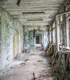 Gloomy corridor with broken window frames and debris Stock Photo