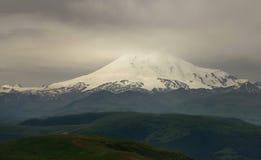 Gloomy Elbrus. This is gloomy Elbrus in Caucasus mountains in morning Stock Photos