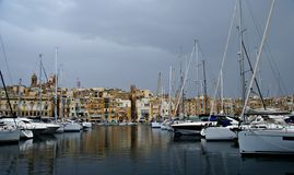 Gloomy evening in the Mediterranean Sea on the Maltese coast. MALTESE ISLAND,EUROPE - NOVEMBER 6, 2014. Gloomy evening in the Mediterranean Sea on the Maltese Royalty Free Stock Photography