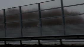 Gloomy fence on the bridge stock video footage