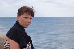 Gloomy girl on the horizon of the sea Royalty Free Stock Photo