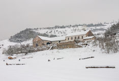 Gloomy haunted farm house barn winter mountain snow Stock Photo