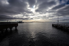 Gloomy heavy rain clouds rolling in from the horizon, calm before storm. Geelong beach, Australia. 