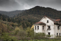 Gloomy house in the woods Stock Photo