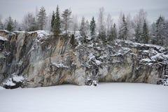 Gloomy January day on the Marble lake. Mountain Ruskeala park. Karelia stock images