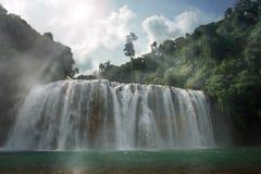 Gloomy jungle waterfall royalty free stock photos