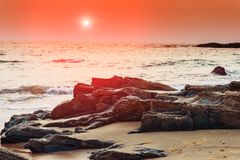 Gloomy landscape seashore at sunset in Goa. Tinted Royalty Free Stock Photography