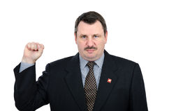 Gloomy man shows gesture of solidarity communists. Gloomy mature man shows gesture of solidarity communists - red front Royalty Free Stock Images