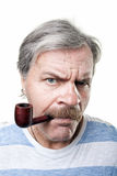 Gloomy mature man with smocking pipe isolated Royalty Free Stock Image