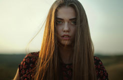Gloomy portrait of young woman Stock Photos