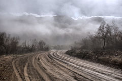 Gloomy road in mountains Stock Photography