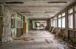 Gloomy school corridor with debris in Pripyat Stock Photography