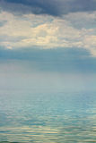 Gloomy skies over mirrored surface of the sea Royalty Free Stock Images