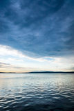 Gloomy sky above lake water Royalty Free Stock Photography