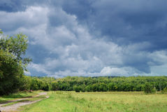 Gloomy sky before thunderstorm. Dull sky before thunderstorm on meadow Royalty Free Stock Photos