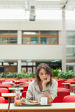 Gloomy student in the cafeteria with food tray Stock Photography