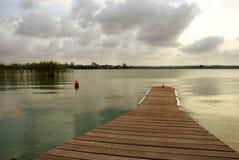 Gloomy summer sunset on the lake Stock Image
