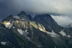 Gloomy summit. This is gloomy summit in Caucasus mountains in evening stock image
