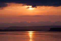 Gloomy sunset on the big river. Stock Photo