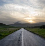 Gloomy sunset on the empty road Stock Photo