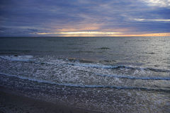 Gloomy sunset over the Baltic sea. A narrow strip of sunset over the dark blue sea Royalty Free Stock Photography