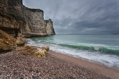 Gloomy weather on rocky coast Royalty Free Stock Images