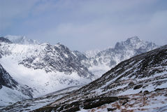 Gloomy weather in winter mountains Royalty Free Stock Photos