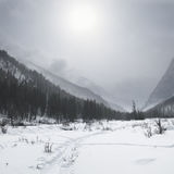 Gloomy weather in winter mountains Stock Images