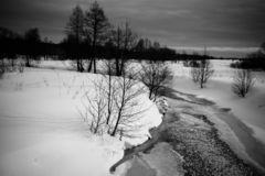 Gloomy weather in winter. Russian provincial landscape. Toned.  stock photography