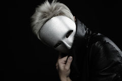 Gloomy woman in silver mask Stock Image