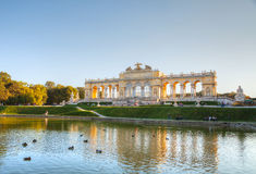 Gloriette Schonbrunn in Vienna at sunset. VIENNA - OCTOBER 06: Gloriette Schonbrunn at sunset with tourists on October 06, 2012 in Vienna. It's the largest and Stock Photos