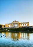 Gloriette Schonbrunn in Vienna at sunset. VIENNA - OCTOBER 06: Gloriette Schonbrunn at sunset with tourists on October 06, 2012 in Vienna. It's the largest and Stock Photography