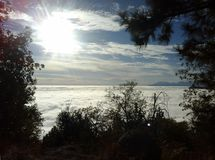 Glorious afternoon light. This image shows a beautiful afternoon in the San Bernardino Mountains of California.  High above the clouds, the sun's is Royalty Free Stock Photo