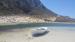 Boat on beach near Gramvousa Island in Crete Stock Photography