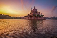 Glorious and colourful sunrise at Putra Mosque. In Putrajaya, Malaysia. This is a famous tourist destination and one of the most beautiful mosques in Malaysia royalty free stock photos