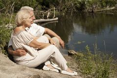 Glorious elderly people went for a walk. Adorable elderly couple went for a walk on spring day Royalty Free Stock Photography