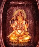 INDIAN GOD LORD GANESHA IDOL IN GOLDEN COLOR royalty free stock photography