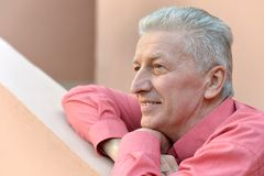 Glorious mature man on terrace Royalty Free Stock Images
